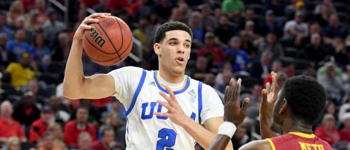 Lonzo Ball #2 of the UCLA Bruins passes against Chimezie Metu #4 of the USC Trojans during a quarterfinal game of the Pac-12 Basketball Tournament at T-Mobile Arena on March 9, 2017 in Las Vegas, Nevada. UCLA won 76-74. (Photo by Ethan Miller/Getty Images)