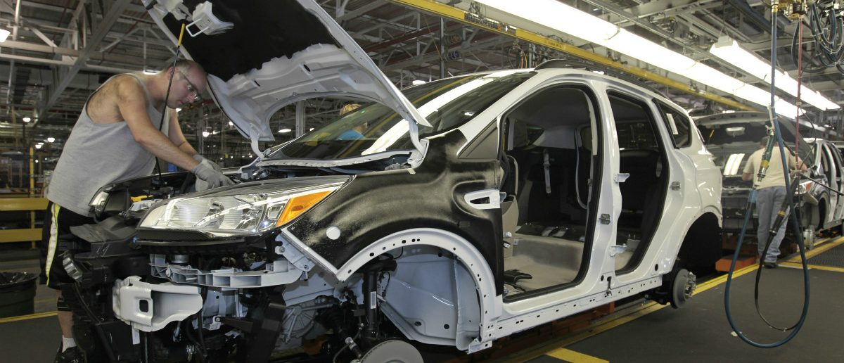 Louisville Assembly Plant employees work to assemble the new 2013 Ford Escape on the production line in Louisville, Kentucky: REUTERS/John Sommers