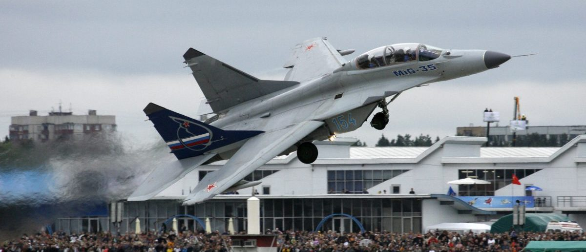 An SU-35 military jet performs during the MAKS-2009 international air show in Zhukovsky outside Moscow August 21, 2009. REUTERS/Sergei Karpukhin