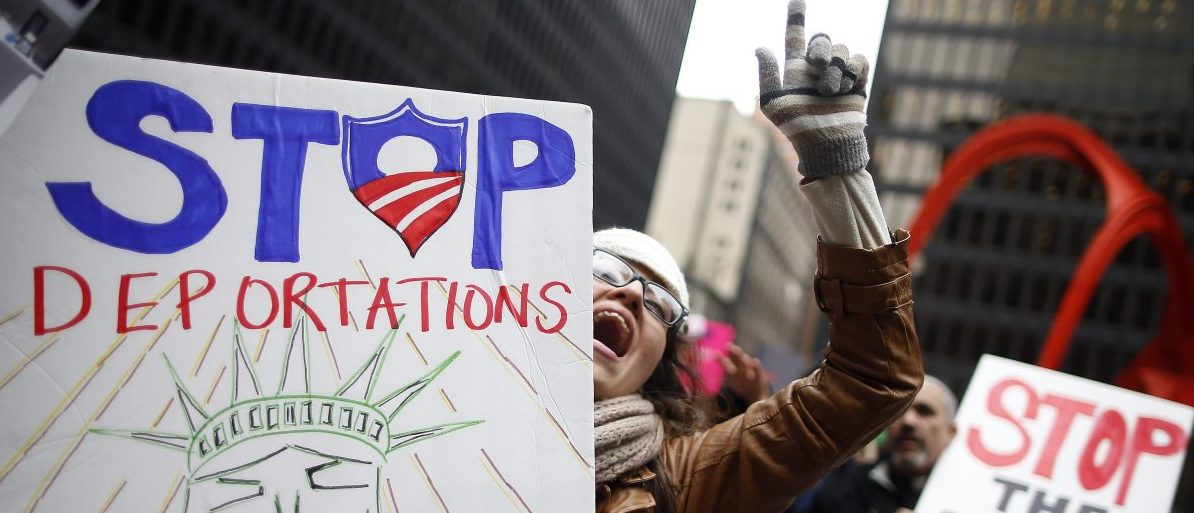 A protester takes part in a demonstration calling for immigration reform at a rally in Chicago, Illinois, March 27, 2014. REUTERS/Jim Young (UNITED STATES - Tags: POLITICS CIVIL UNREST TPX IMAGES OF THE DAY) - RTR3IWQ3