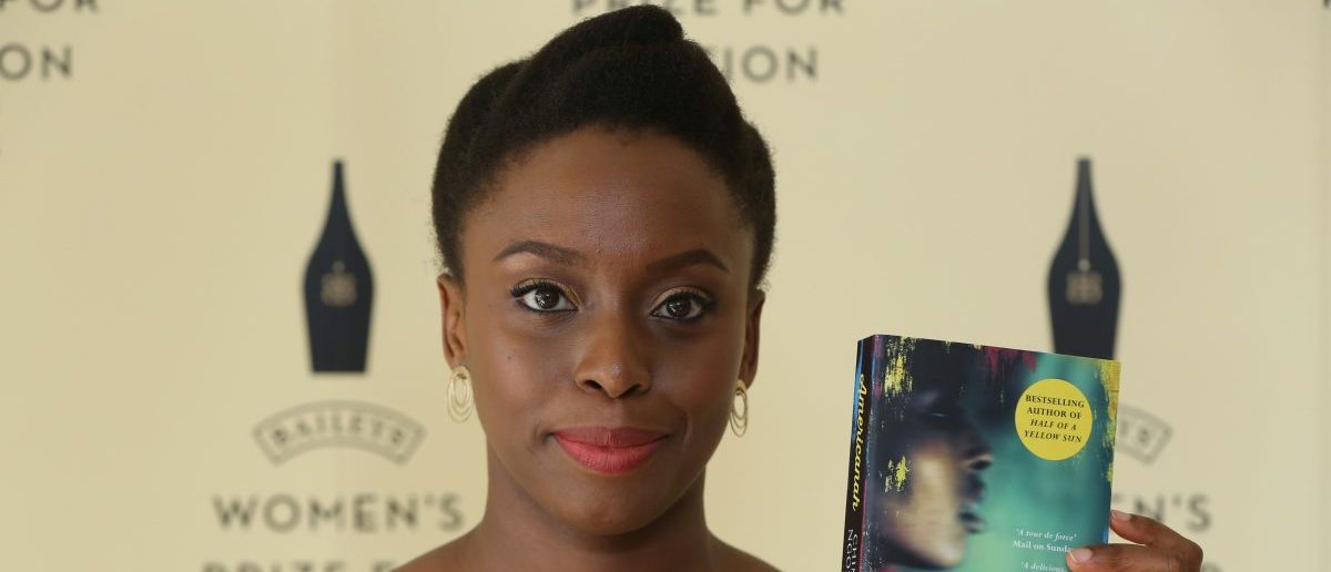 "Author Chimamanda Ngozi Adichie poses with her novel ""Americanah"" ahead of the 2014 Bailey's Women's Prize for Fiction in London June 4, 2014. Irish author Eimear McBride won the 2014 Bailey's Women's Prize for Fiction on Wednesday for her first novel, ""A Girl is a Half-Formed Thing"", which took her 10 years to get published. REUTERS/Neil Hall"