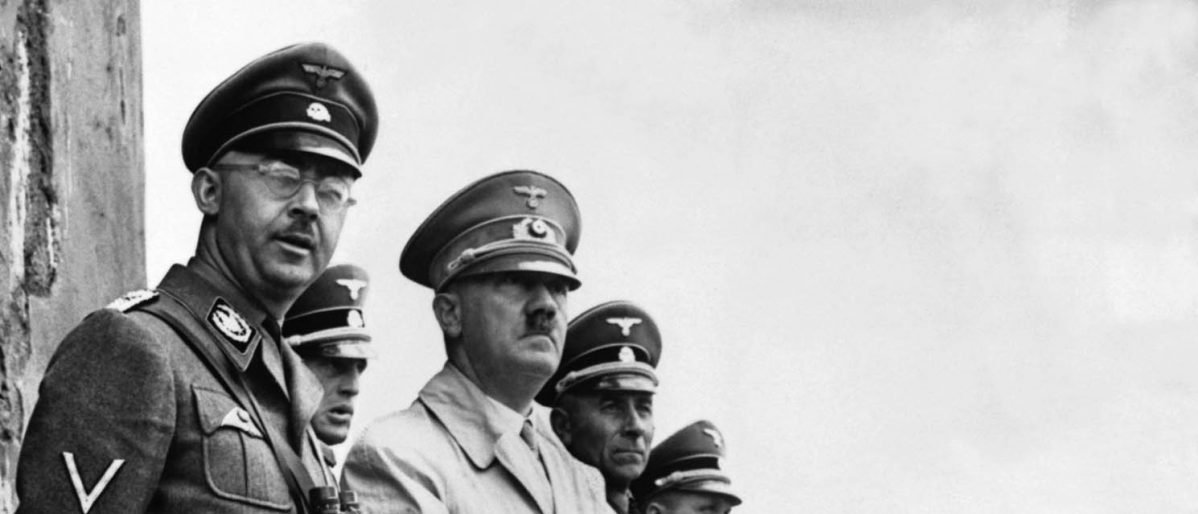 The United States Central Intelligence Agency released files on Adolf Hitler (C) and 19 others April 27, 2001, including some who eventually worked with the U.S. and other intelligence agencies and evaded prosecution during the Cold War. Hitler stands beside Heinrich Himmler, the head of the Gestapo, to observe a parade of Nazi Stormtroopers in this file photo from 1940. Source: Reuters