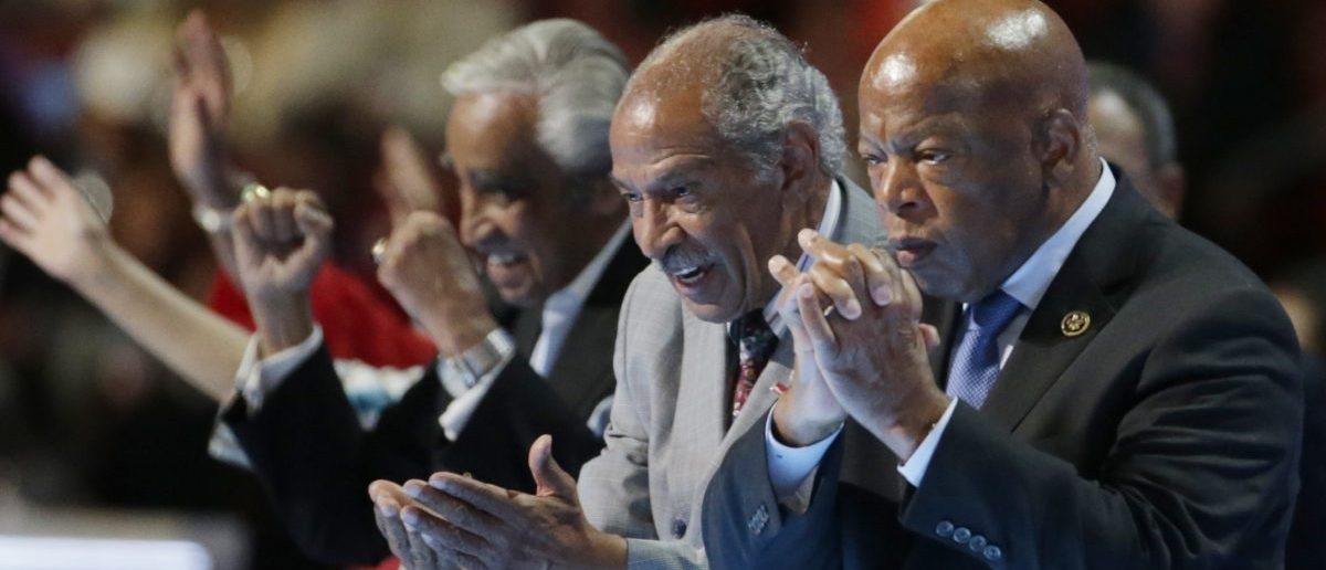 Members of the Congressional Black Caucus wave from the stage at the Democratic National Convention in Philadelphia, Pennsylvania, U.S. July 27, 2016. REUTERS/Gary Cameron