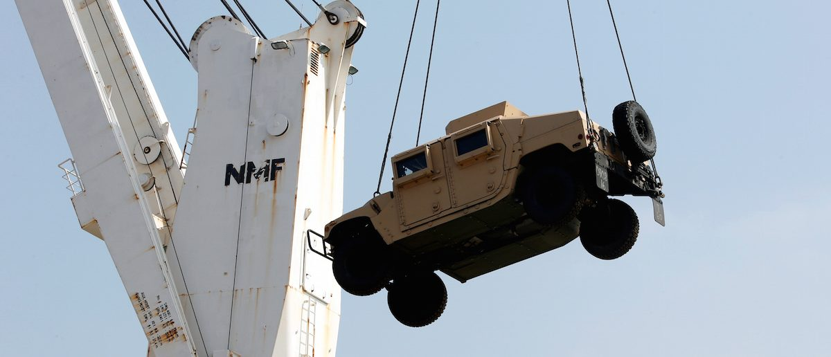 Workers unload a Humvee, in Lebanon (Photo: REUTERS/Mohamed Azakir)