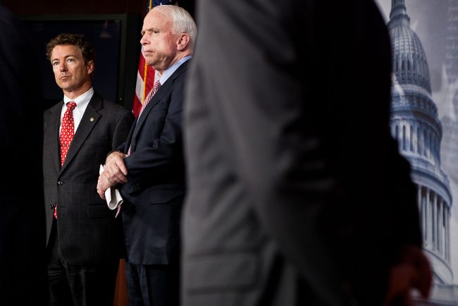 Sen. Rand Paul (R-KY) and Sen. John McCain (R-AZ) listen during a news conference on Capitol Hill to introduce a Republican jobs proposal to compete with that put forward by President Obama on October 13, 2011 in Washington, D.C. (Photo by Brendan Hoffman/Getty Images)