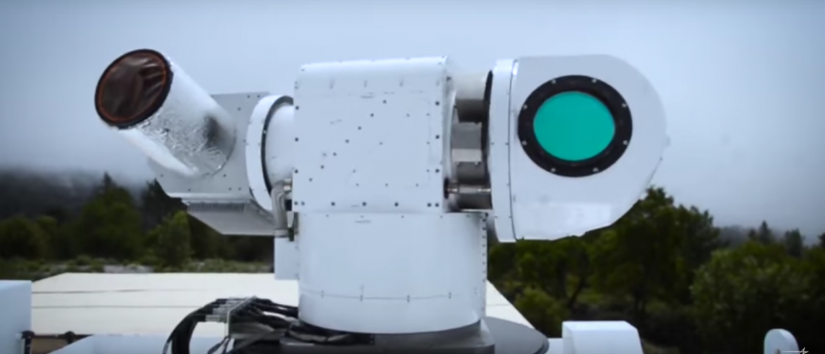 A laser weapon system readies to fire on its target. Source: YouTube