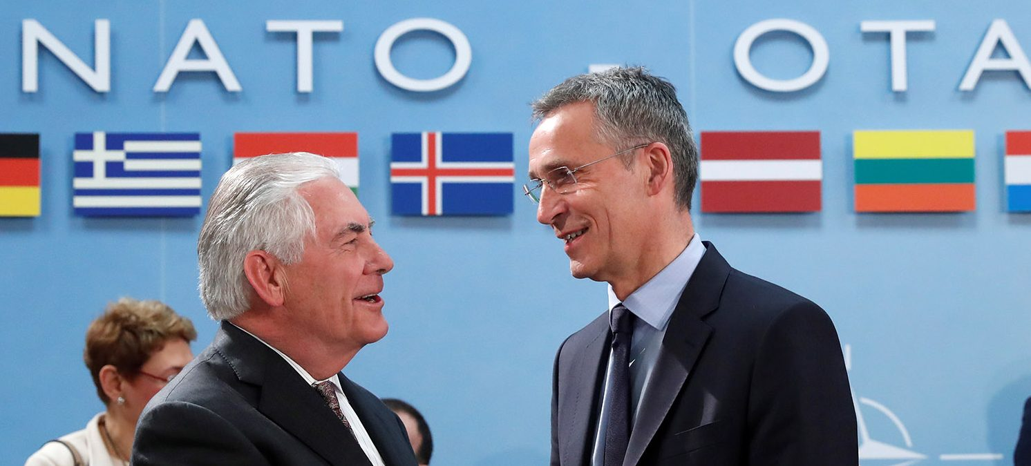 U.S. Secretary of State Rex Tillerson (L) shakes hands with NATO Secretary General Jens Stoltenberg during a NATO foreign ministers meeting at the Alliance's headquarters in Brussels, Belgium March 31, 2017. (PHOTO: REUTERS/Yves Herman)