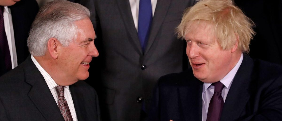 U.S. Secretary of State Rex Tillerson and British Foreign Secretary Boris Johnson take part in a meeting of NATO foreign ministers at the Alliance's headquarters in Brussels, Belgium March 31, 2017. REUTERS/Yves Herman