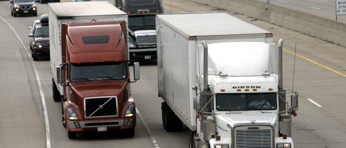 Two freight trucks are driven on the Fisher freeway in Detroit, Michigan, U.S. Reuters/Rebecca Cook