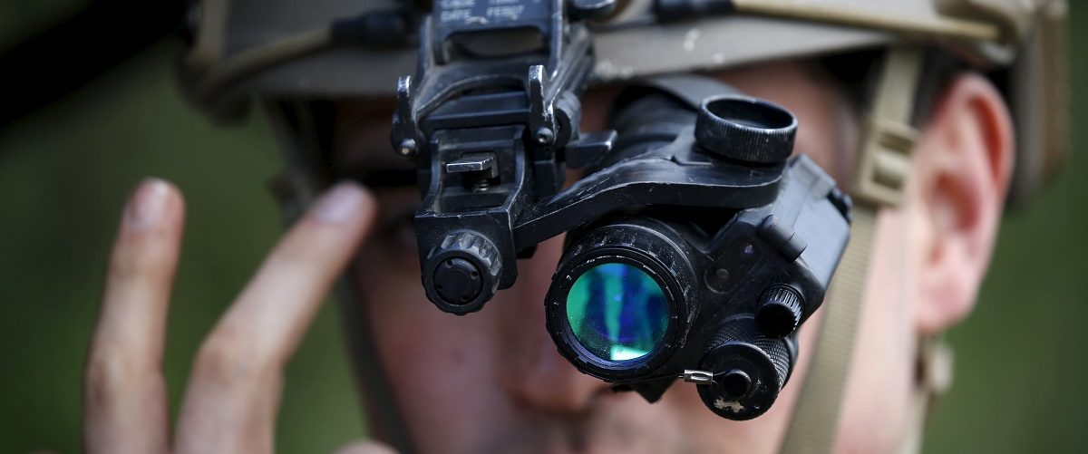 A U.S. Air Force Forward air controller adjusts his night vision goggles during the close air support (CAS) exercise Serpentex 2016 hosted by France in the Mediterranean island of Corsica