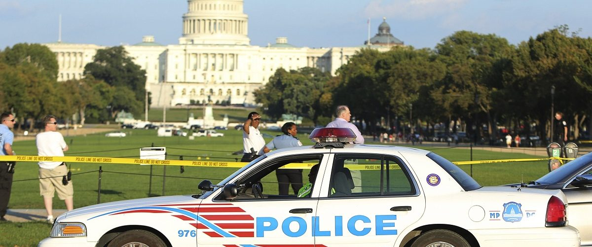 A Washington police car arrives at the scene where a man set himself on fire near the U.S. Capitol on the U.S. National Mall in Washington