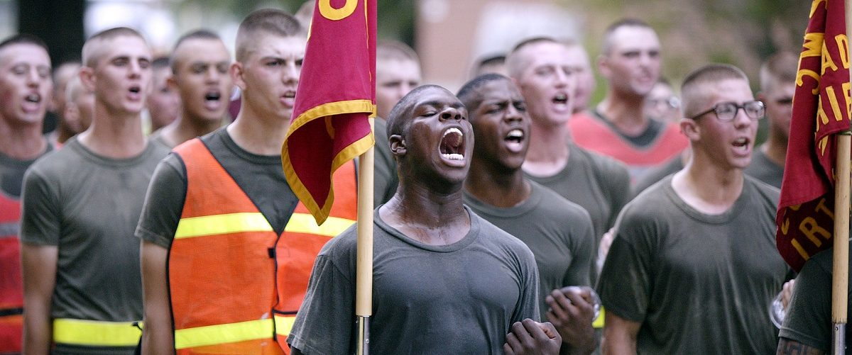 Recruit Temyrance Johnson (C) responds to a motivational speech being made by the commanding officer of the recruit training regiment following the recruit?s final run before graduation from boot camp at the United States Marine Corps Recruit Depot June 24, 2004 in Parris Island, South Carolina. Marine Corps boot camp, with its combination of strict discipline and exhaustive physical training, is considered the most rigorous of the armed forces recruit training. Congress is currently considering bills that could increase the size of the Marine Corps and the Army to help meet US military demands in Iraq and Afghanistan. Scott Olson/Getty Images.