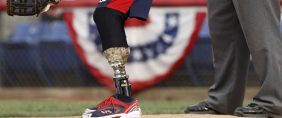 Wounded Warrior Amputee Softball Team catcher Matias Ferreira (L) awaits a pitch during their game against the Broome County, New York Law Enforcement team in Binghamton, New York May 26, 2012. The Wounded Warrior team is a collection of United States military veterans who have lost limbs during their service in Iraq and Afghanistan, and tours the country playing competitive softball games against local teams. REUTERS/Gary Cameron.