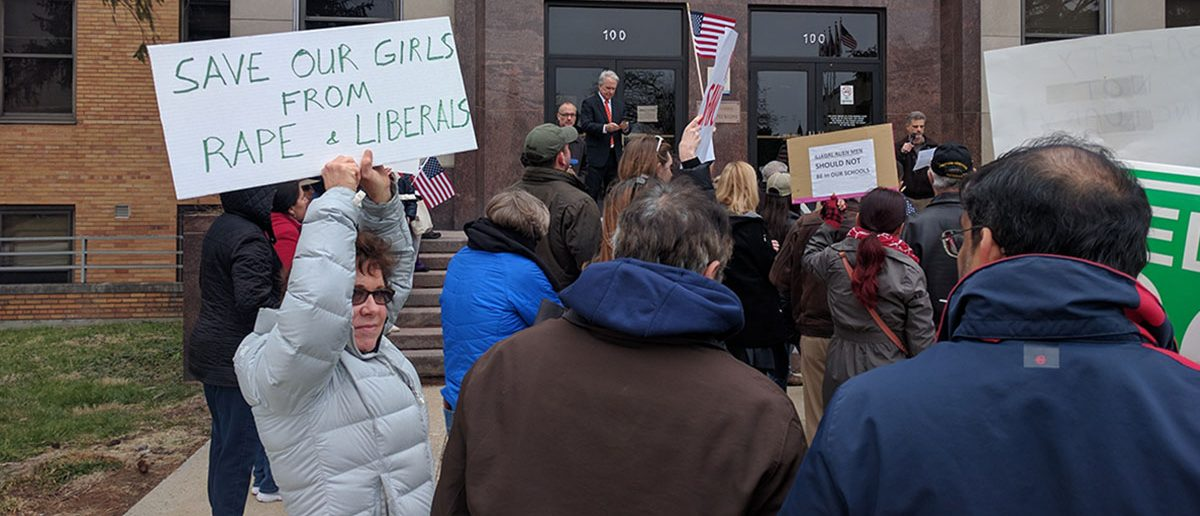 Protesters voice their concerns about Montgomery County's sanctuary policy during a rally at the county council building on March 26, 2017. (Will Racke | Daily Caller News Foundation)