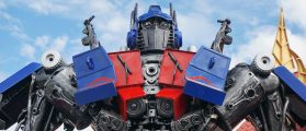AYUTTAYA,THAILAND - AUGUST 09, 2015 : The Replica of Optimus Prime robot made from iron part of a Car display at Thung Bua Chom floating market (Shutterstock/Wasan Ritthawon)