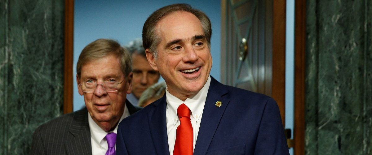 David Shulkin (R) arrives with Senate Veterans Affairs Committee Chairman Johnny Isakson for his confirmation hearing on his nomination to be Veterans Affairs secretary on Capitol Hill in Washington, U.S., February 1, 2017.  REUTERS/Kevin Lamarque.