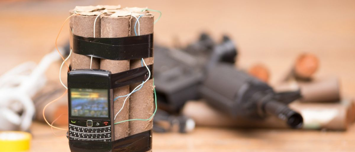 A homemade bomb and rifle. Source: Shutterstock/Fotos593