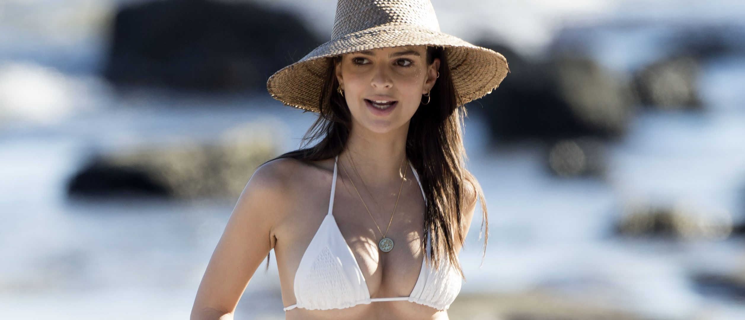 Emily Ratajkowski sun bathes at Paradise Cove in Malibu, Calif. (Photo: Splash News)