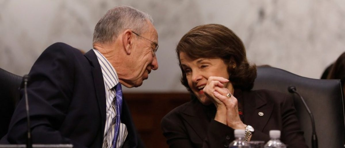 Chairman Sen. Chuck Grassley speaks to Ranking Member Diane Feinstein during a meeting of the Senate Judiciary Committee to discuss the nomination of Judge Neil Gorsuch to the Supreme Court on Capitol Hill in Washington, D.C., U.S., April 3, 2017. REUTERS/Aaron P. Bernstein