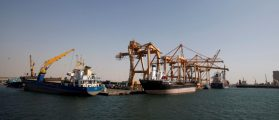 FILE PHOTO: Ships are docked next to giant cranes, damaged by Saudi-led air strikes, at a container terminal at the Red Sea port of Hodeidah, Yemen November 16, 2016.  REUTERS/Khaled Abdullah/File Photo