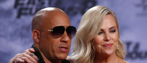 """Actors Vin Diesel and Charlize Theron pose at the premiere of the """"Fast and Furious 8"""" movie in Berlin, Germany, April 4, 2017."""