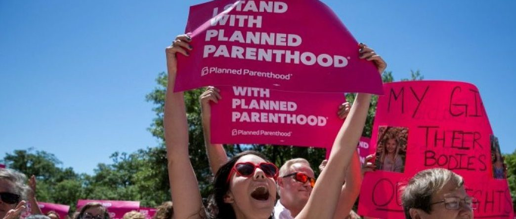 Claire Contreras, 30, reacts as she listens to Former State Senator Wendy Davis speak during a Planned Parenthood rally outside the State Capitol in Austin, Texas, U.S., April 5, 2017.    REUTERS/Ilana Panich-Linsman