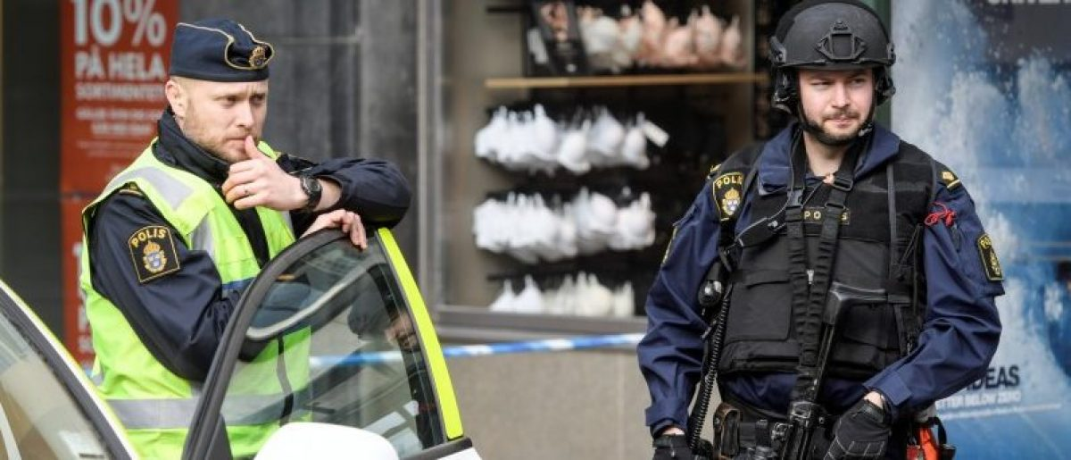 Police in central Stockholm near the crime scene on April 08, 2017, the day after a hijacked beer truck plowed into pedestrians on Drottninggatan and crashed into Ahlens department store on Friday, killing four people, injuring 15 others. TT News Agency/Anders Wiklund/via REUTERS