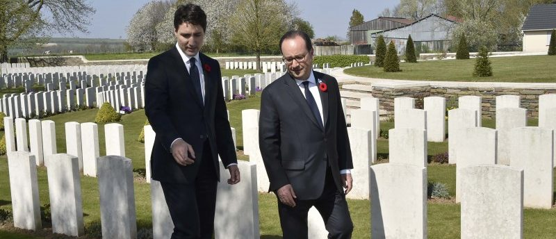 French President Francois Hollande (R) and Canadian Prime Minister Justin Trudeau walk in the Canadian WWI military cemetery during a commemoration ceremony to mark the 100th anniversary of the Battle of Vimy Ridge, in Vimy, near Arras, northern France, on April 9, 2017. REUTERS/Philippe Huguen
