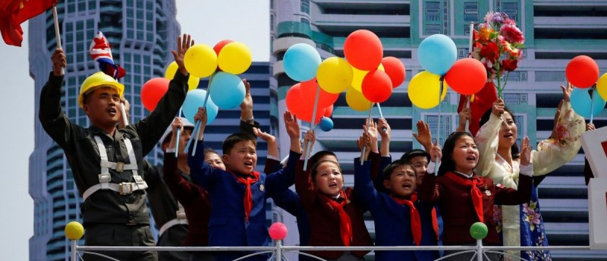 People react as they pass in front of the stand with North Korean leader Kim Jong Un during a military parade marking the 105th birth anniversary of country's founding father Kim Il Sung, in Pyongyang April 15, 2017.  REUTERS/Damir Sagolj