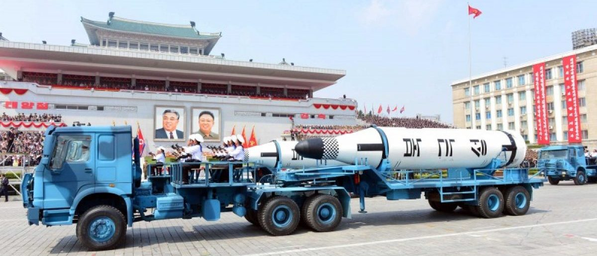 "Military vehicles carry missiles with characters reading ""Pukkuksong"" during a military parade marking the 105th birth anniversary of country's founding father Kim Il Sung, in this undated photo, released by North Korea's Korean Central News Agency (KCNA), April 16, 2017. Picture taken April 16, 2017. REUTERS/KCNA"