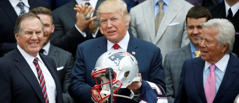 U.S. President Donald Trump holds a New England Patriots helmet as Coach Bill Belichick (L) and CEO of the New England Patriots Robert Kraft, watch during an event honoring the Super Bowl champion team at the White House in Washington, U.S., April 19, 2017. REUTERS/Joshua Roberts