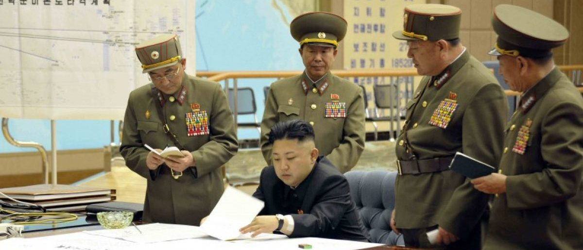 "North Korean leader Kim Jong-un presides over an urgent operation meeting on the Korean People's Army Strategic Rocket Force's performance of duty for firepower strike at the Supreme Command in Pyongyang. The sign on the left reads, ""Strategic force's plan to hit the mainland of the U.S."".  REUTERS/KCNA"