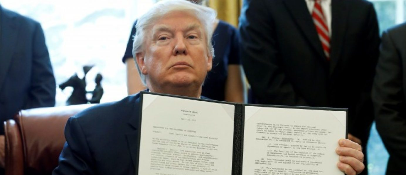 U.S. President Donald Trump holds up a directive ordering an investigation into the impact of foreign steel on the American economy after signing it in the Oval Office of the White House in Washington, U.S., April 20, 2017. REUTERS/Aaron P. Bernstein