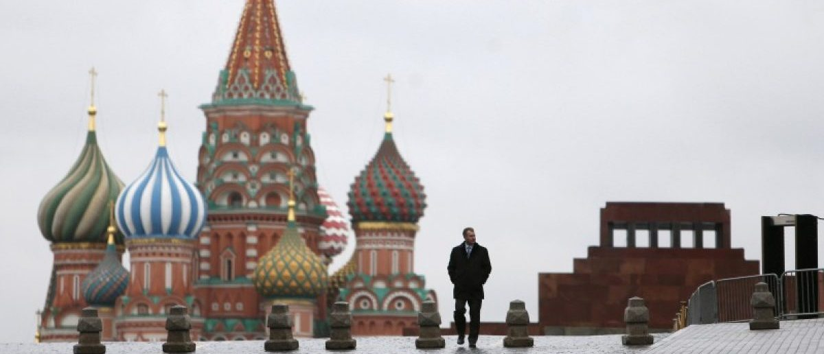 FILE PHOTO: A man walks along Red Square, with the mausoleum of Soviet state founder Vladimir Lenin (R) and St. Basil's Cathedral seen in the background, in central Moscow, Russia December 21, 2015. REUTERS/Maxim Shemetov/File Photo