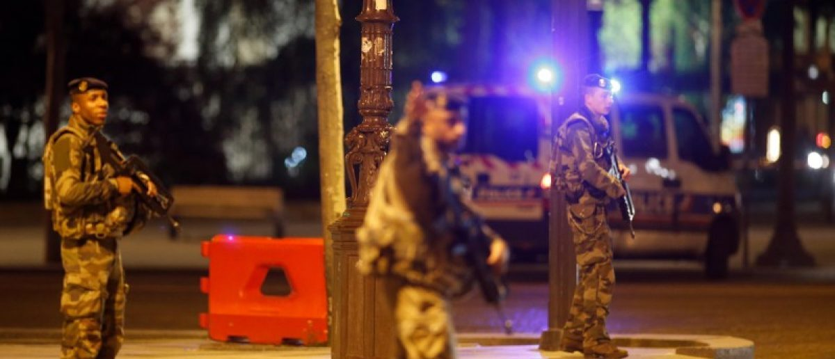 Armed soldiers secure the Champs Elysees Avenue after two policemen were killed and another wounded in a shooting incident in Paris, France, April 20, 2017. REUTERS/Benoit Tessier