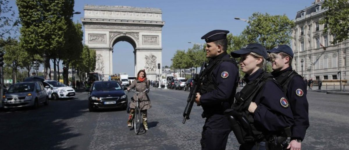 Armed French police patrol the Champs Elysees Avenue the day after a policeman was killed and two others were wounded in a shooting incident in Paris, France, April 21, 2017. REUTERS/Benoit Tessier