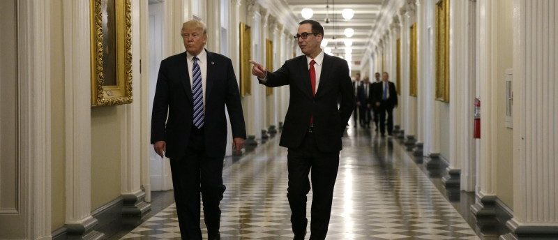 U.S. President Donald Trump (L) arrives with Treasury Secretary Steven Mnuchin prior to signing financial services executive orders at the Treasury Department in Washington, U.S., April 21, 2017. REUTERS/Kevin Lamarque
