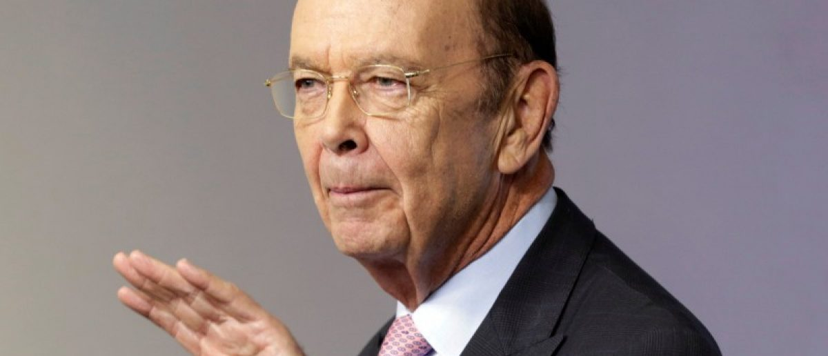 Commerce Secretary Wilbur Ross waves after speaking from the White House in Washington