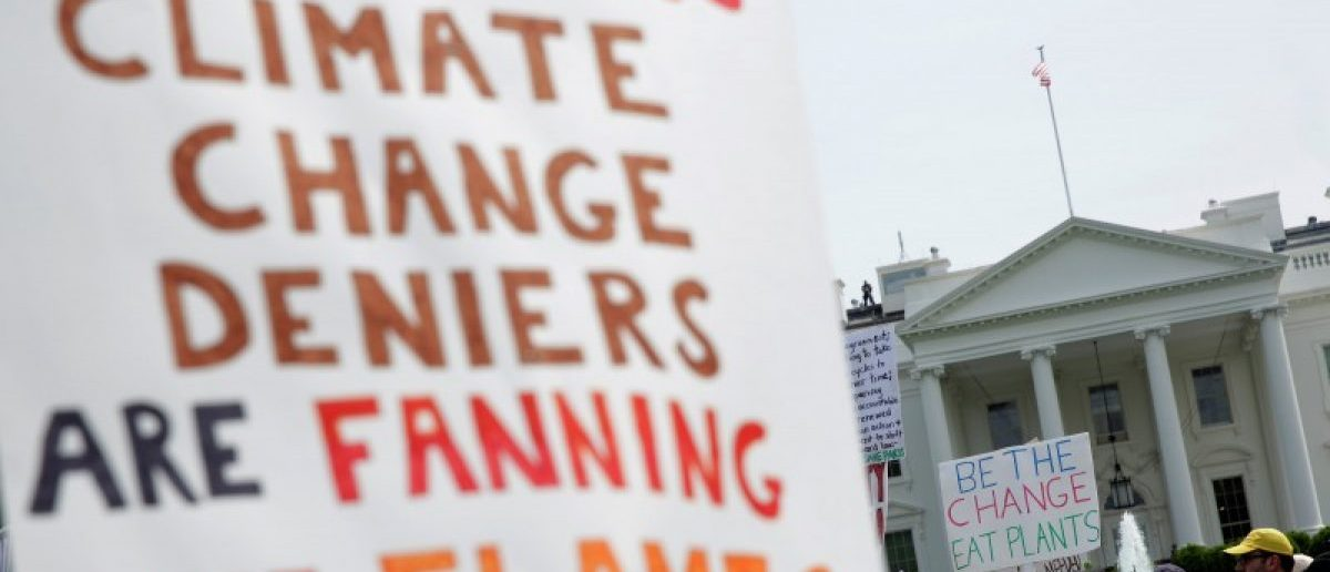 Protesters carry signs during the Peoples Climate March at the White House in Washington