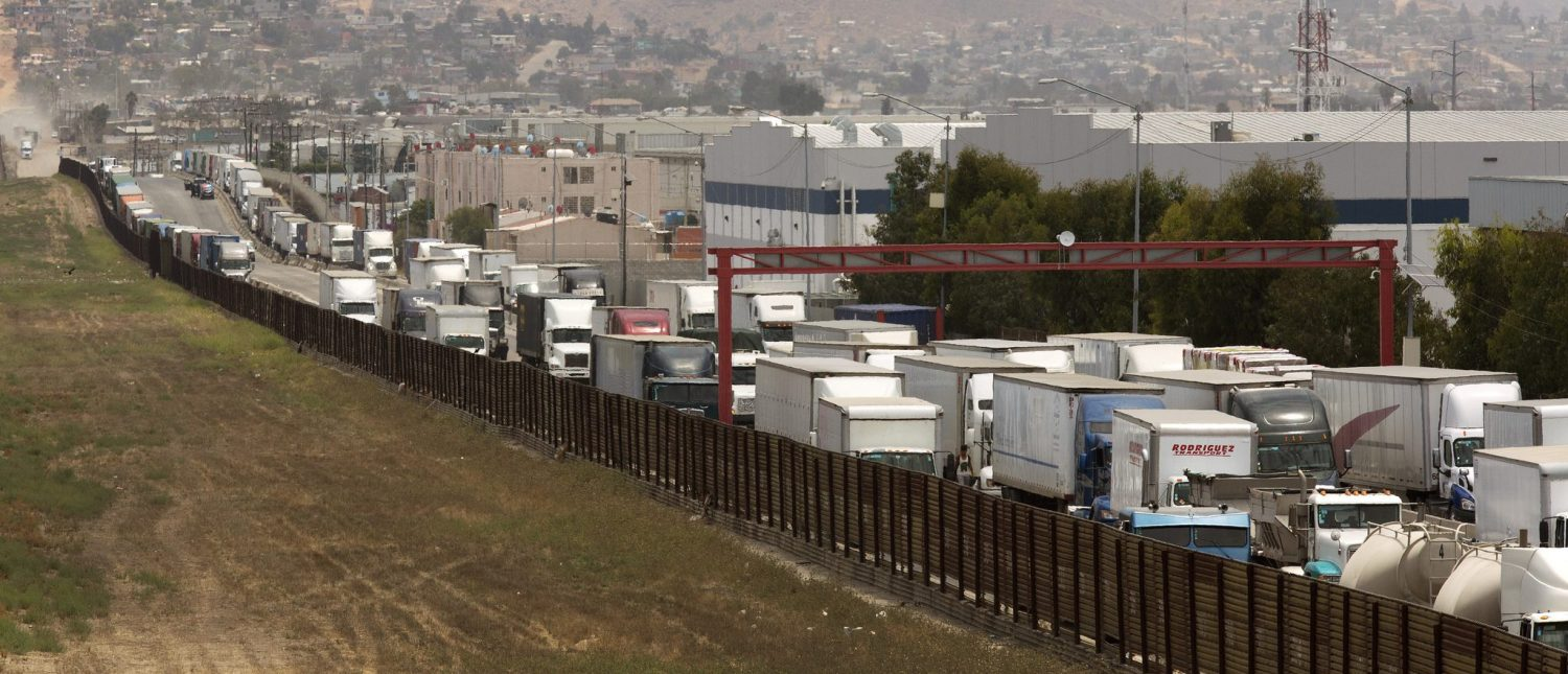 A long line of tractor trailers await entry into the U.S. from Mexico at the Otay Mesa, Calif., port of entry, June 22, 2016. (CBP Photo by Glenn Fawcett)