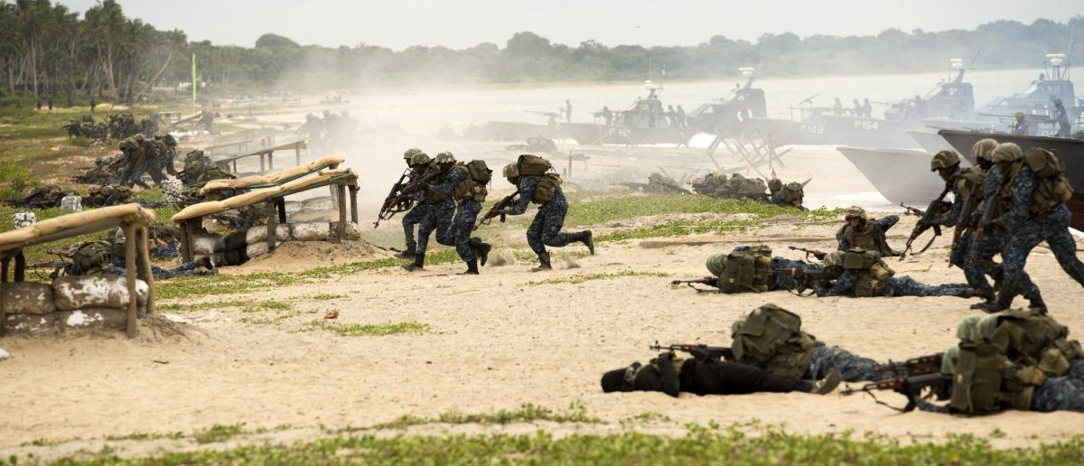Sri Lankan Marines assault a beach as part of an amphibious capabilities demonstration during the Sri Lanka Marine Corps Boot Camp graduation at Sri Lankan Naval Station Barana in Mullikulum, Sri Lanka, Feb. 27, 2017. The SLMC will be an expeditionary force with specific missions of humanitarian assistance, disaster relief and peacekeeping support.   (U.S. Marine Corps photo by Lance Cpl. Robert Sweet)