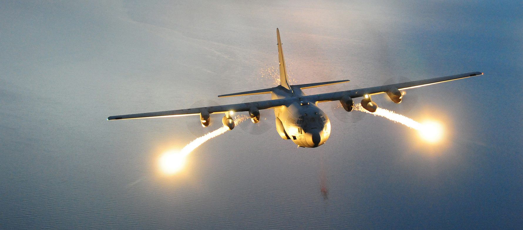 A U.S. Air Force C-130 Hercules cargo aircraft with the 107th Airlift Wing fires off flares during a night formation training mission. A flare is an aerial infrared countermeasure to counter and infrared homing (heat seeking) surface-to-air or air-to-air missile. (U.S. Air Force photo by Senior Master Sgt. Ray Lloyd)