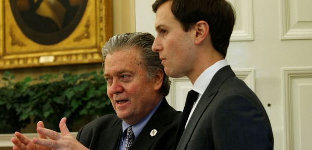 White House chief strategist Steve Bannon (L) and senior advisor Jared Kushner speak after U.S. President Donald Trump signed an executive order at the White House in Washington, U.S. February 3, 2017. (PHOTO: REUTERS/Kevin Lamarque)