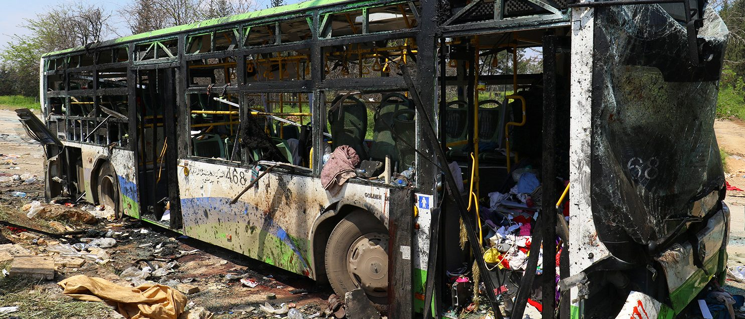 A damaged bus is seen after an explosion yesterday at insurgent-held al-Rashideen, Aleppo province, Syria April 16, 2017. (PHOTO: REUTERS/Ammar Abdullah)