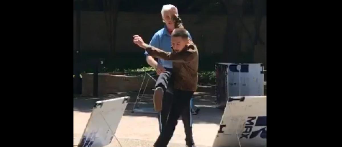 Student kicks pro-life sign (Twitter Video/Emma Brockway )