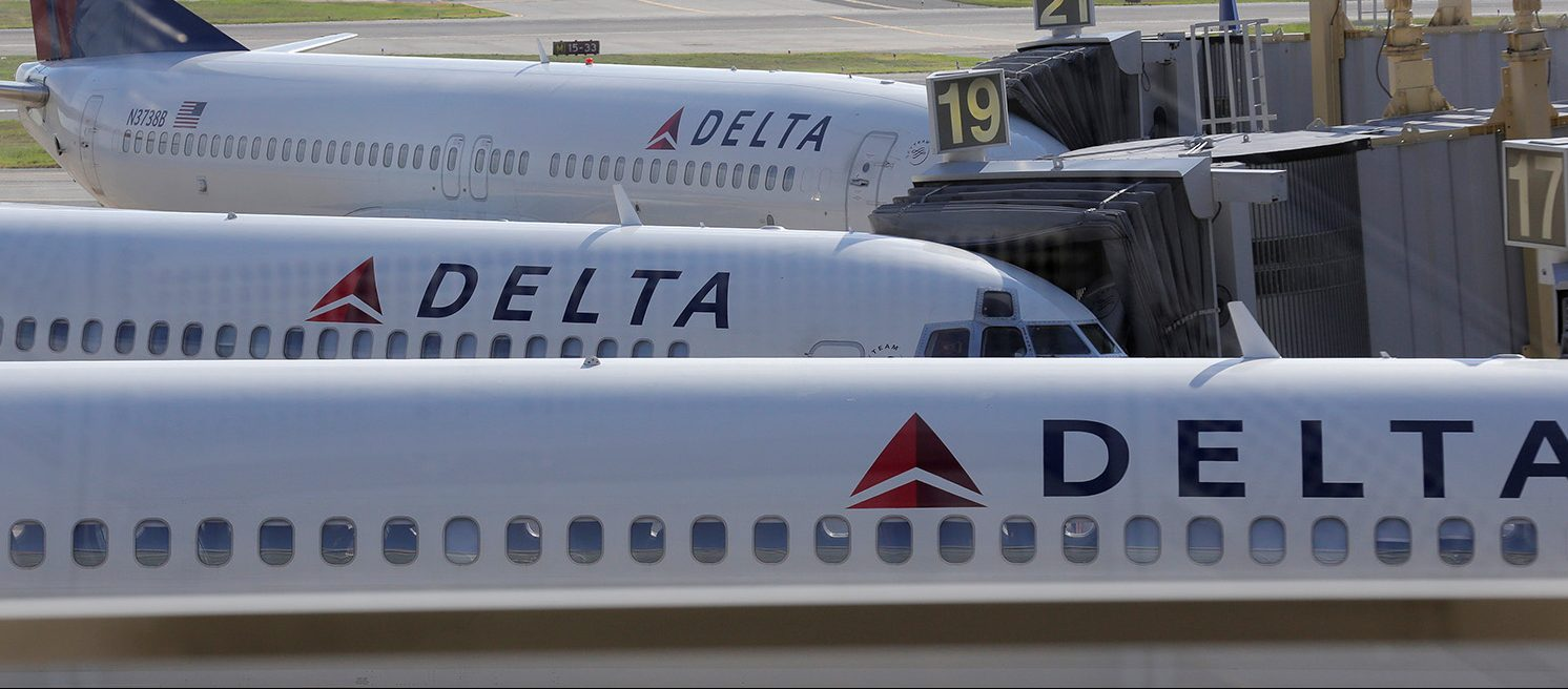 Delta Airlines planes are parked at gates after the airlines computer systems crashed leaving passengers stranded as flights were grounded globally at Ronald Reagan Washington National Airport in Washington, U.S., August 8, 2016. (PHOTO: REUTERS/Joshua Roberts)
