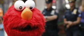 A person dressed as the Sesame Street character Elmo walks through Times Square in New York July 29, 2014. REUTERS/Shannon Stapleton