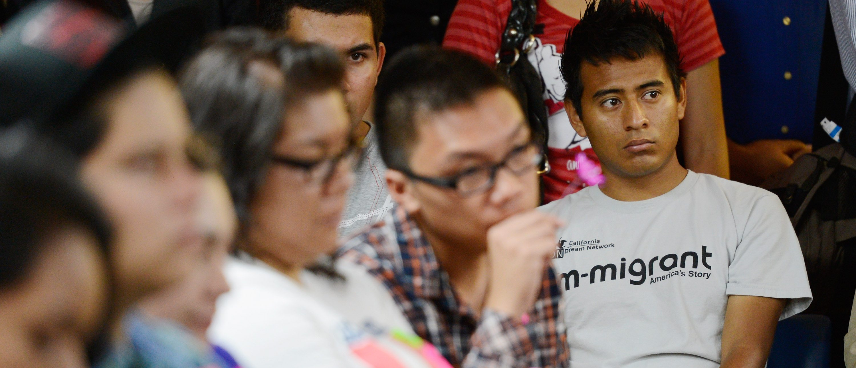 LOS ANGELES, CA - AUGUST 15: A group of immigrants, known as DREAMers, hold flowers as they listen to a news conference to kick off a new program called Deferred Action for Childhood Arrivals at the Coalition for Humane Immigrant Rights of Los Angeles on August 15, 2012 in Los Angeles, California. Under a new program established by the Obama administration undocumented youth who qualify for the program, called Deferred Action for Childhood Arrivals, can file applications from the U.S. Citizenship and Immigration Services website to avoid deportation and obtain the right to work (Photo by Kevork Djansezian/Getty Images)