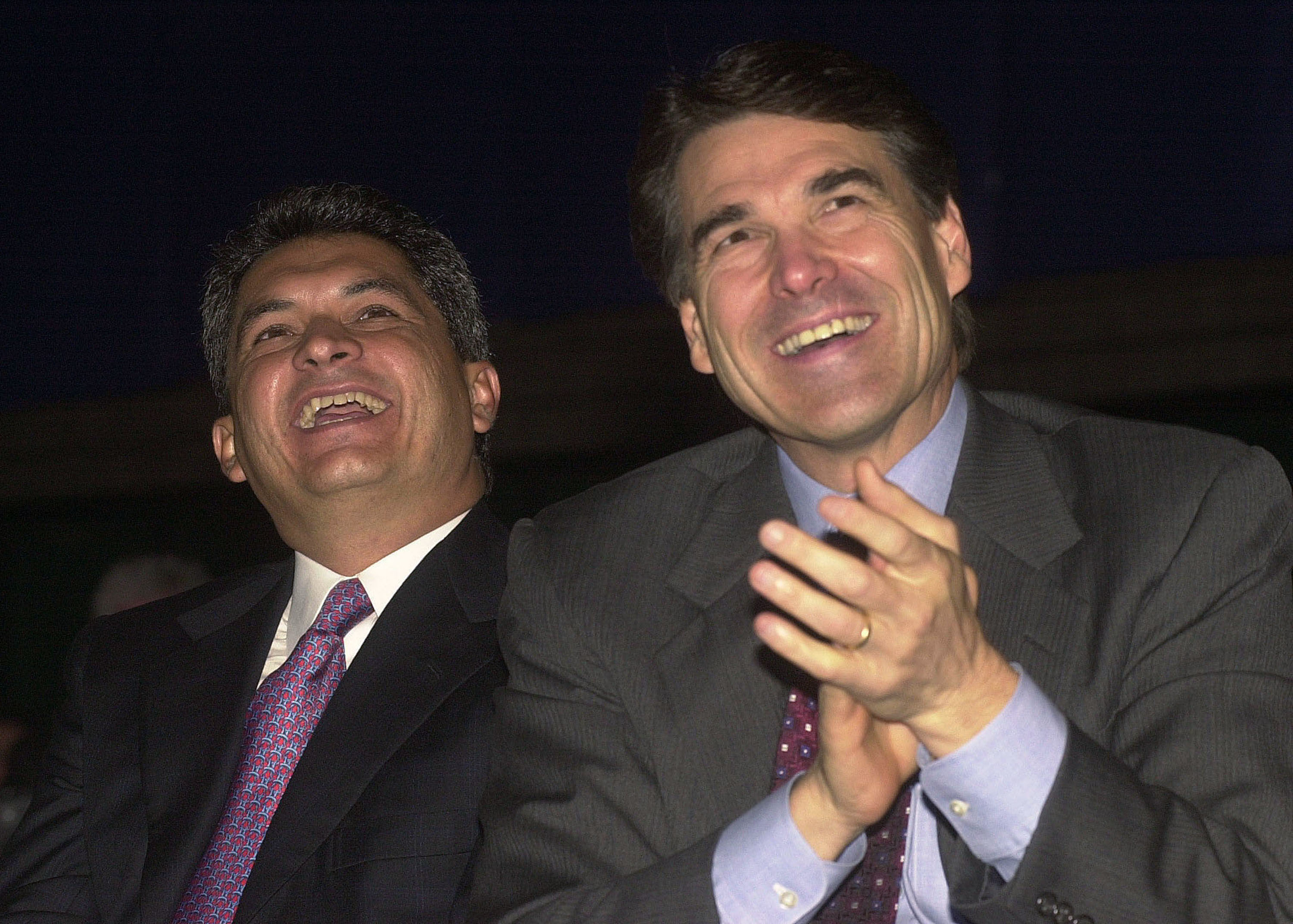 Governor Tomas Yarrington (L) of the state of Tamaulipas, Mexico, and Texas Governor Rick Perry listen to remarks during the U.S. and Mexico Border Summit August, 22, 2001 in Edinburg, TX. (Photo by Alicia Wagner Calzada/Getty Images)