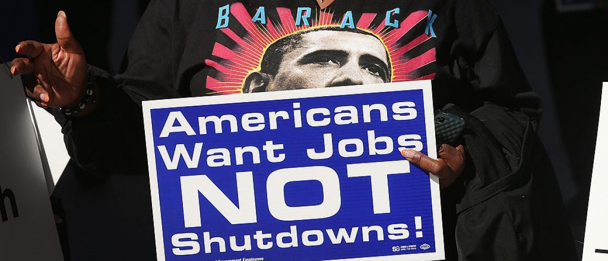 Catherine Wriddley carries a sign during a protest and prayer vigil held to call for an end to the federal government shutdown on October 8, 2013. (Photo: Getty Images/Scott Olson)